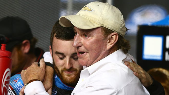 Team owner Richard Childress (right) embraces grandson Austin Dillon after he clinched the Nationwide Series title.