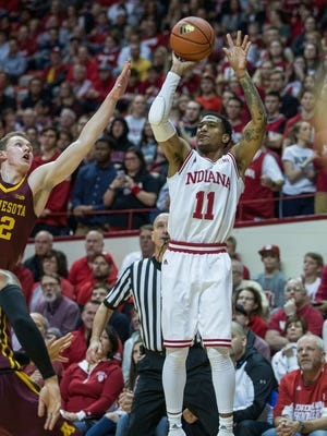 Hoosiers guard Devonte Green (11) shoots the ball against Minnesota Golden Gophers forward Michael Hurt (42) in the first half at Assembly Hall.