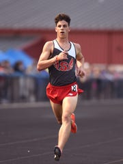 Sheridan's Luke Brown cruises to a win in the 3,200 during the Muskingum Valley League Track and Field Championships on Friday at Maysville High School.  Brown helped the 3,200 relay advance to the state on Thursday.