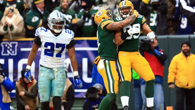 Green Bay Packers tight end Richard Rodgers (89) celebrates with Andrew Quarless after scoring a touchdown against Dallas Cowboys free safety J.J. Wilcox in the fourth quarter of the 2014 NFC divisional playoff football game at Lambeau Field.