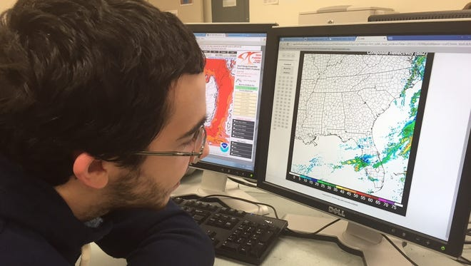 The College at Brockport student Aidan Kuroski looks at data about Tampa weather for his forecast.