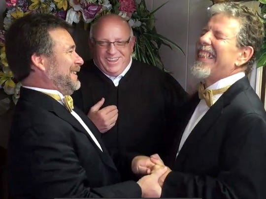 Carl Fox (right) can't hold back a big smile during his marriage to Terry L. Bond, Jr.
