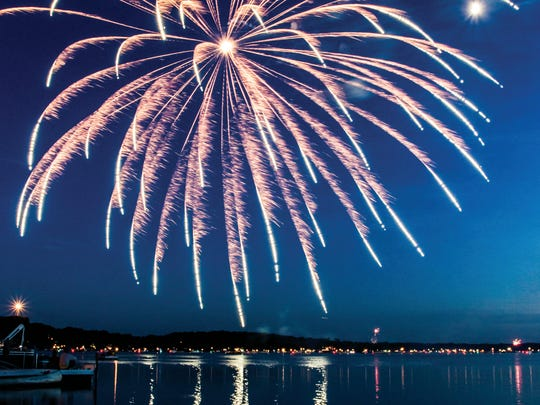 Fireworks reflect off the still waters of Pewaukee Lake creating a spectacular 4th of July display.