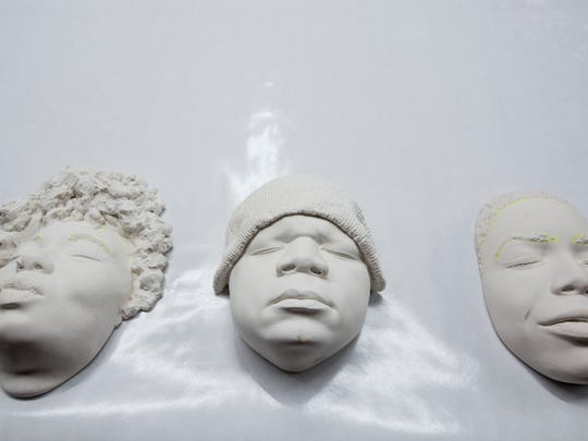 Cast faces rest on a table for attendees to inspect during the face casting demonstration on Saturday, Jan. 30, 2016, at the Red Bull House of Art in Detroit.