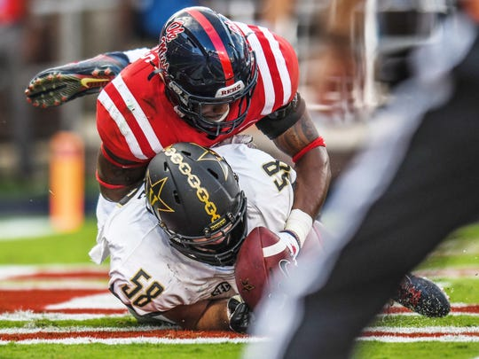 Mississippi linebacker DeMarquis Gates (3) tackles Vanderbilt offensive lineman Justin Skule (58) for a safety following a Vanderbilt fumble during an NCAA college football game Saturday, Oct. 14, 2017, in Oxford, Miss. (Bruce Newman/The Oxford Eagle via AP)