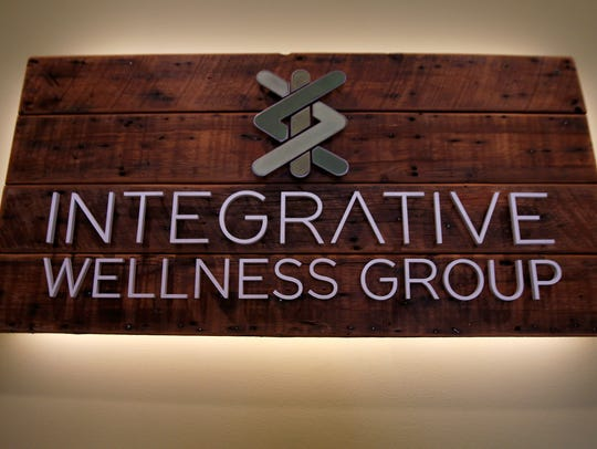 A sign in the lobby for the Integrative Wellness Group