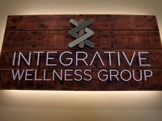 A sign in the lobby for the Integrative Wellness Group in Belmar shown Wednesday, January 31, 2018.   The practice is dedicated to providing a range of wellness testing, holistic healing therapies and spa services.