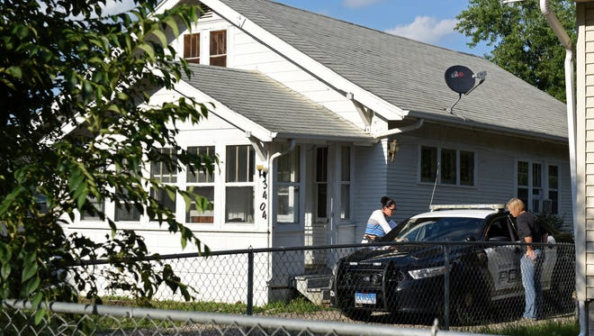 The crime lab investigates a home on N. 8th Ave. off E. Hermosa Dr. after a homicide in Sioux Falls, S.D., Saturday, July 23, 2016.