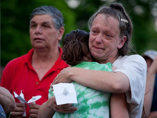 Kim Nuckoles hugs Tiffany Nuckoles, 15, after the teenager spoke about her friendship with Julian Parrott during the vigil being held for him at Gypsy Hill Park on May 12.