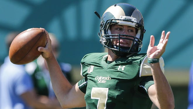 Junior Nick Stevens, shown preparing to pass last year in a game against Minnesota, and the other quarterbacks competing for the starting job at CSU this fall will be airing the ball out a lot during the final scrimmage of fall camp Saturday, coach Mike Bobo said.