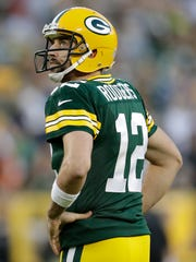 Green Bay Packers' Aaron Rodgers reacts after throwing