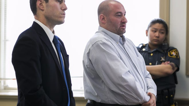 From left, defense lawyer Brent Bramnick with former bookkeeper Frank Larocca, at Larocca's sentencing May 27, 2016 for stealing from comic Joe Piscopo.