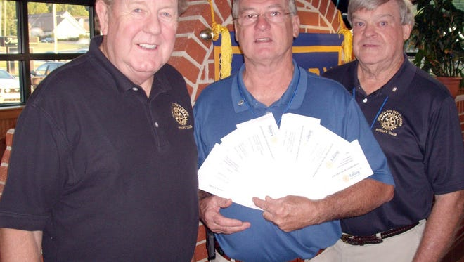 Shown from left, are club members Wayne Frady, Eddie Perry, past president and Tri-State Relays director and Don Lesley, club president.