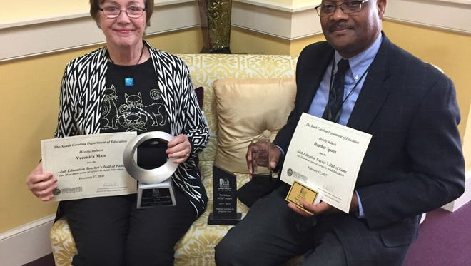 Veronica Main, ESL coordinator and instructor for Oconee Adult Education, and Gene Williams, program director, were recognized for 23 years of service to adult education.