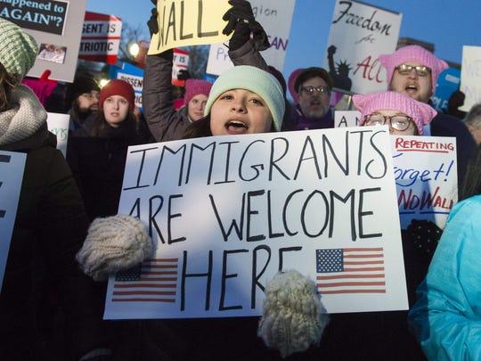 Demonstrators protest against President Trump's executive