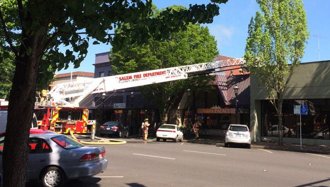 Crews respond to a fire reported at the India Palace restaurant on Court Street.
