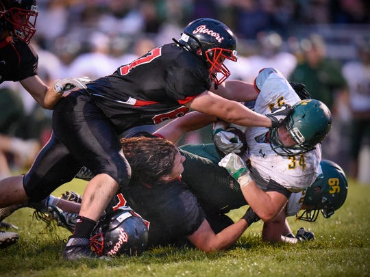 Rocori players team up to tackle Eric Moline of Sauk Rapids during the Friday, Sept. 16, game in Cold Spring.
