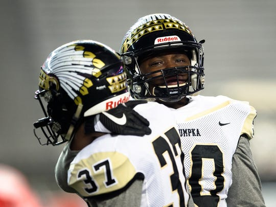 Wetumpka's Denzel Surles embraces Wetumpka's Ethan Nettles after the AHSAA Class 6A Football State Championship on Friday, Dec. 8, 2017, in Tuscaloosa, Ala. Pinson Valley defeated Wetumpka 31-10.