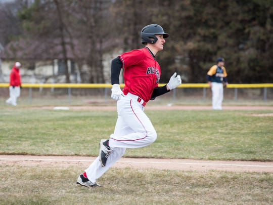 Port Huron High School pitcher Brett Wagner runs to first base during their baseball game against Port Huron Northern High School Wednesday, April 18.
