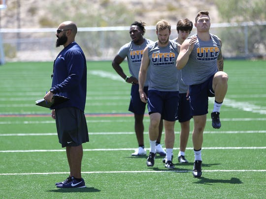 UTEP strength and conditioning coach Kevin Schadt leads practice on July 17, 2018, at Glory Road Field.