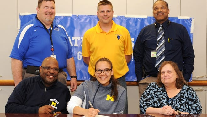 Renee Reed signed a letter of intent to play basketball for the University of Michigan-Dearborn.