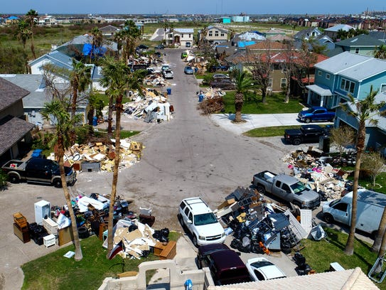 Debris from homes damaged by Hurricanes Harvey line