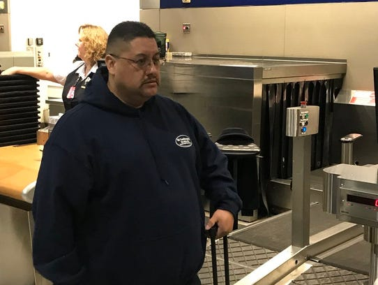 Jorge Garcia, 39, of Lincoln Park stands at the ticket counter at Detroit Metro Airport checking his bags on Jan. 15, 2018. He was to be deported to Mexico.