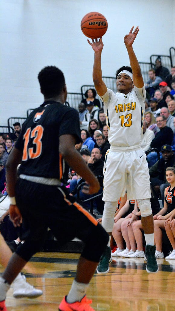 D'Andre Davis (right) and York Catholic enter the District 3 3-A tournament as the No. 2 seed and, by virute of the top-four teams from the bracket making states, have already qualified for the state tournament. John A. Pavoncello
