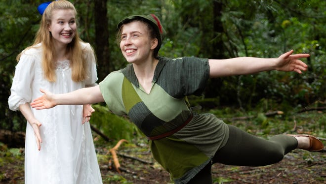 Peter Pan (Anna Vizzare) describes the wonderfulness of flying to an enthralled Wendy (Juliette Jones).
