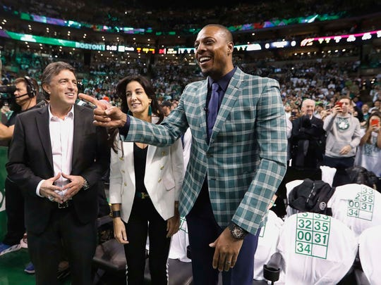 Former Boston Celtics forward Paul Pierce smiles and acknowledges cheers as team owner Wyc Grousbeck and his wife Emilia Fazzalari look on during the first quarter against the Cleveland Cavaliers at TD Garden in a February, 2018 game.