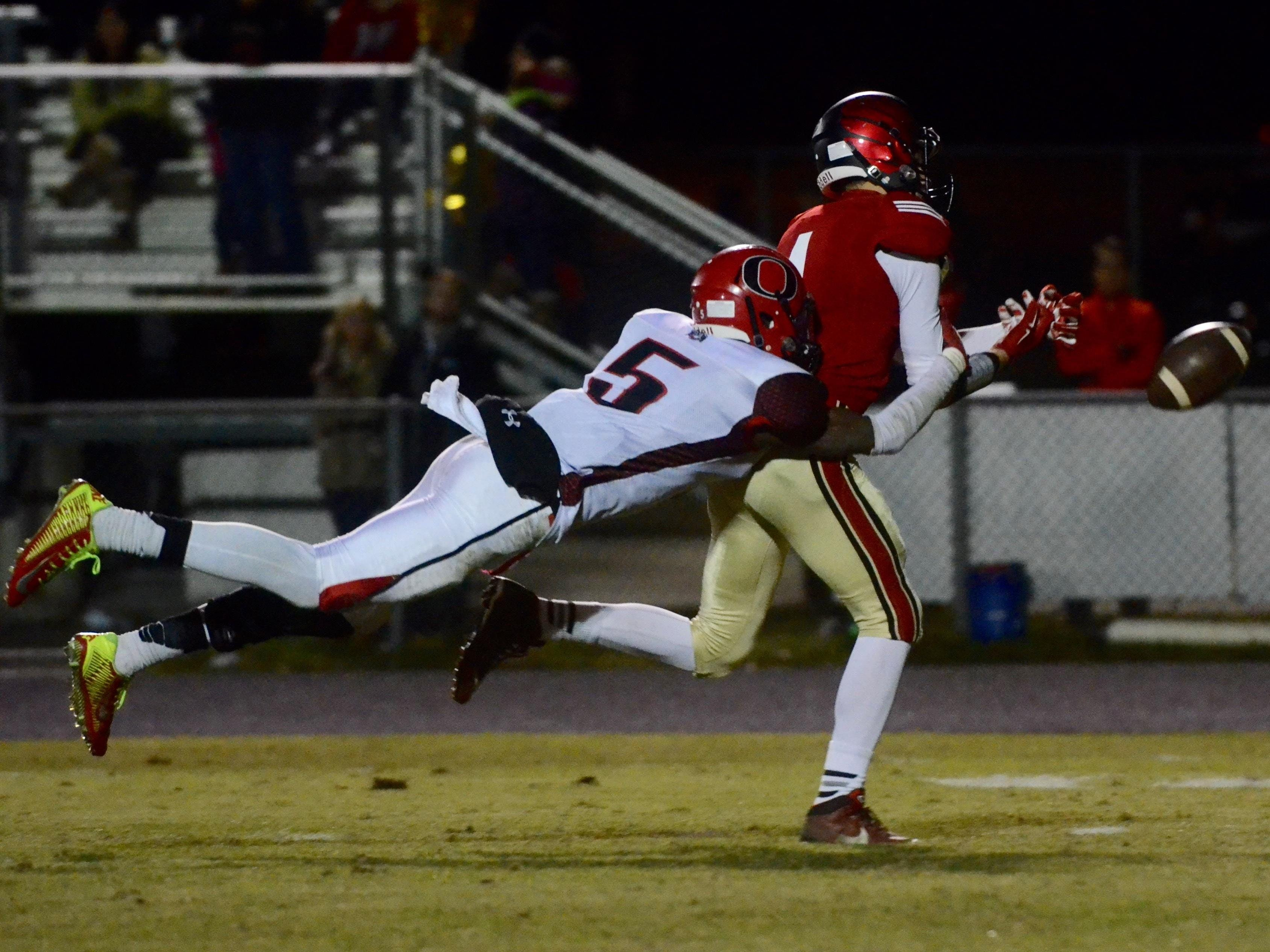 Overton's Theo Jackson (left) makes a play.