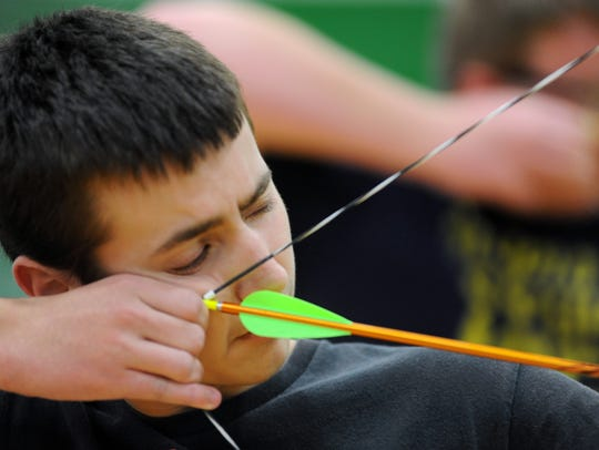 Huntington freshman Bailey Arledge takes aim at a target