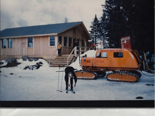 Photo taken in 1956 shows a Tucker brand Sno Cat parked in front of the Smugglers' Notch Ski Ways Sterling summit shelter called Smugglers' Roost. The Ski Ways' opening season was in 1956. Skiers could head to the shelter to warm up after runs on a network of six trails.