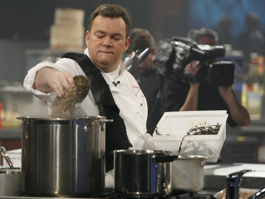 Peter X. Kelly of the Xaviars Restaurant Group in Rockland County, participates in the Iron Chef competition during a taping for the Food Network Oct. 17, 2006, in New York.  He faced off against Chef Bobby Flay.  ( Mark Vergari / The Journal News )