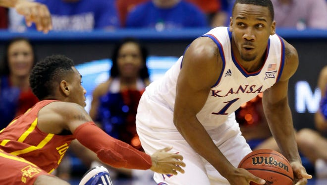 Kansas guard Wayne Selden Jr. (1) gets to a loose ball before Iowa State guard Monte Morris, left, during the first half of an NCAA college basketball game in Lawrence, Kan., Monday, Feb. 2, 2015.