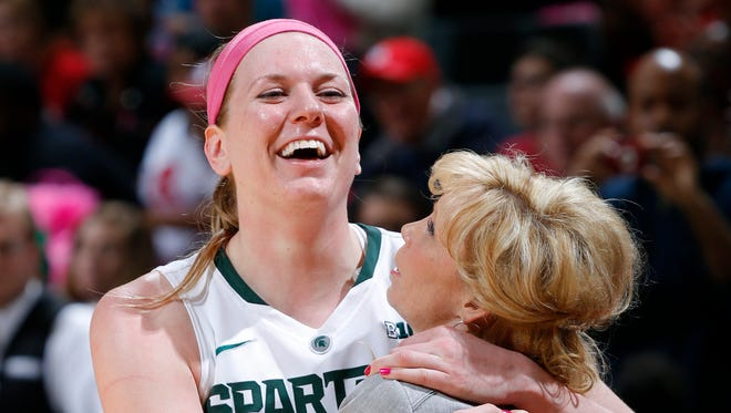 Michigan State senior Becca Mills hugs coach Suzy Merchant as she comes out of the game for the final time against Rutgers on Sunday.
