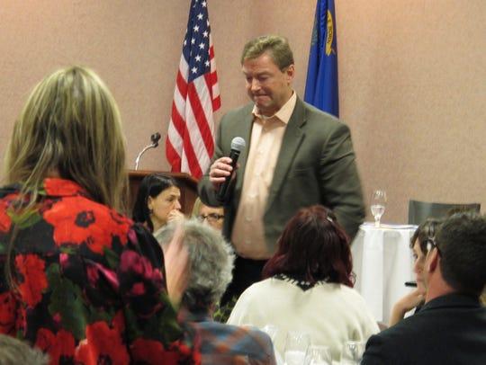 Sen. Dean Heller, R-Nev., listens to a question during