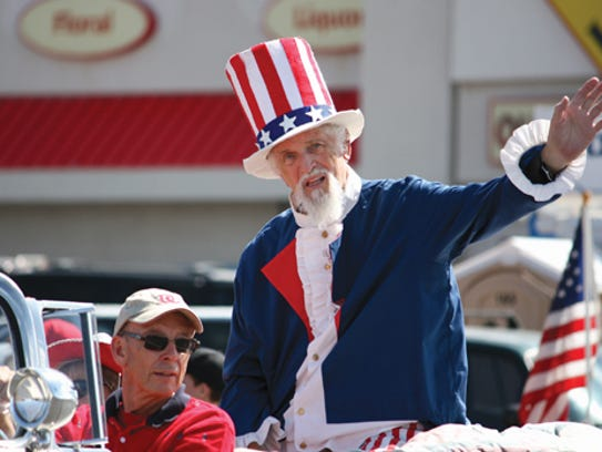 In this file photo Uncle Sam waves to a crowd of onlookers