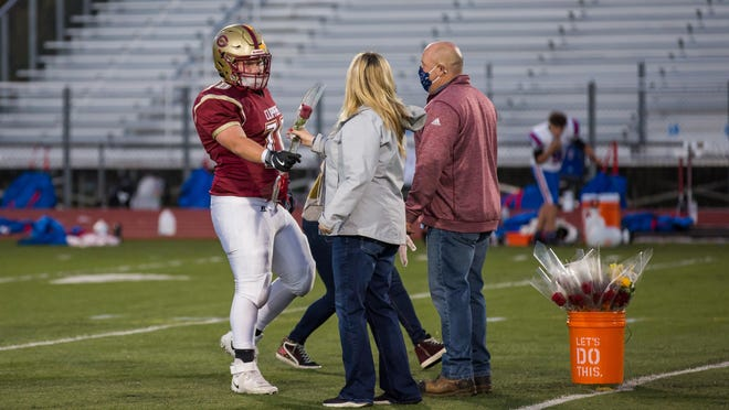 Portsmouth High School's Joey Gobbi greets his parents on the field during Friday's senior night ceremony at Tom Daubney Field.