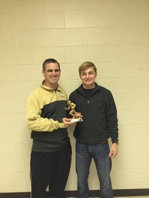 OCS coach Steven Fitzhugh accepts the High school Hero Award with quarterback Chance Clowers.