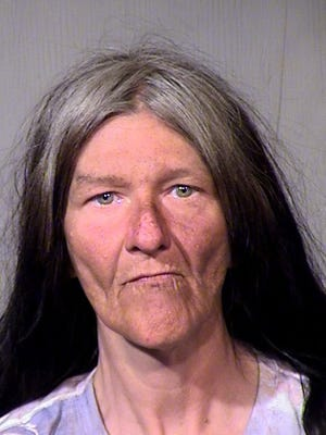Phoenix police are asking the public to help identify this woman, seen here in a booking photo. Her body was found in Phoenix on June 28, 2016.
