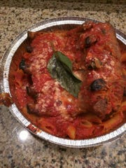Pizza Mia's Nonna's Sunday dinner is an Italian feast including five falling-off-the-bone ribs, two moist and tender meatballs, a  Italian sausage and plenty of penne pasta, smothered in Nonna's Sunday gravy and a half-dozen fresh garlic knots.