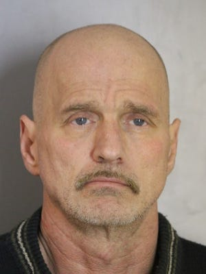 Daniel Woods, 55, was charged with burglary, but not after leading state troopers on a car chase through a golf course, several farm fields and the back yard of a home, police said.