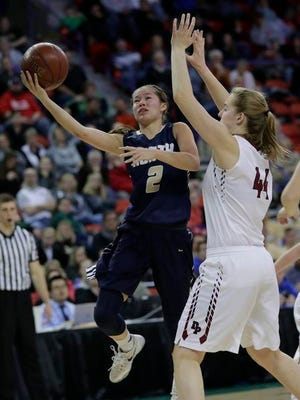 Appleton North High School's Kari Brekke (2) shoots against De Pere High School's Liz Nies (44) during their WIAA Division 1 State Tournament final girls basketball game Saturday, March 11, 2017, at the Resch Center in Ashwaubenon, Wis.
