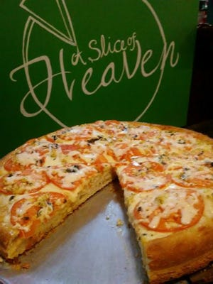 A Slice of Heaven's Chicago-style deep dish fresca pizza was topped with fresh sliced tomatoes, garlic, olive oil and fresh sliced basil.