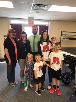 Late Test Intermediate  teacher Anthony Armstrong's family poses for a photo as Armstrong was named the district's honorary Teacher of the Month. Those in the photo include his mother, Evelyn Strong, far left, along with sister Emily Elsen, brother Nathan Armstrong, wife  Falon Armstrong and children Gavin, Maddux and Nora.