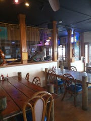 The inside dining rooms at The Old Fish House have