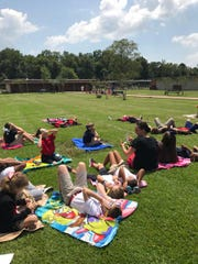 Students at Phoenix Magnet view the eclipse.