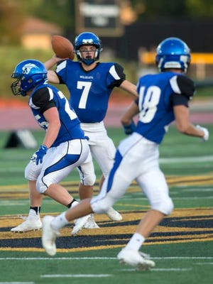 Oshkosh West's Ben Kohl targets a pass to A.J. Ambroso on J.J. Keller Field at Titan Stadium Friday in a game against Wausau West August 25, 2017.