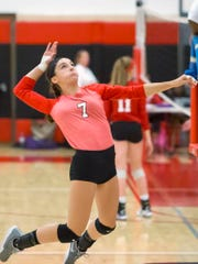 Lourdes Academy's Rachel Aasby goes up for a kill shot Saturday during the Lourdes Academy volleyball invite September 2, 2017.